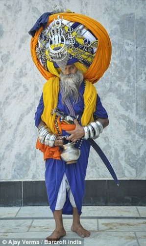 The Turbanator: Devout Sikh wears the world's largest turban that takes him six hours to put on and weighs 100lb